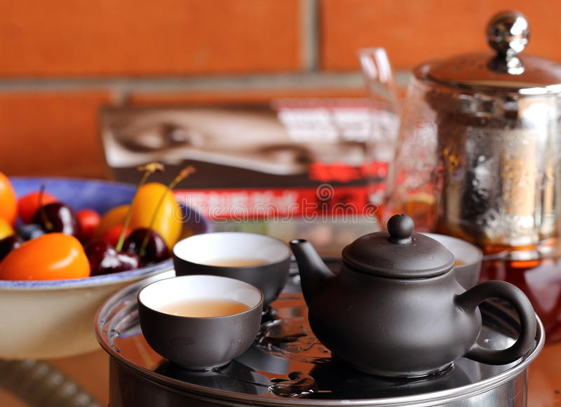 Chinese Tea, Fruits, Jug and Book on Table stock photography
