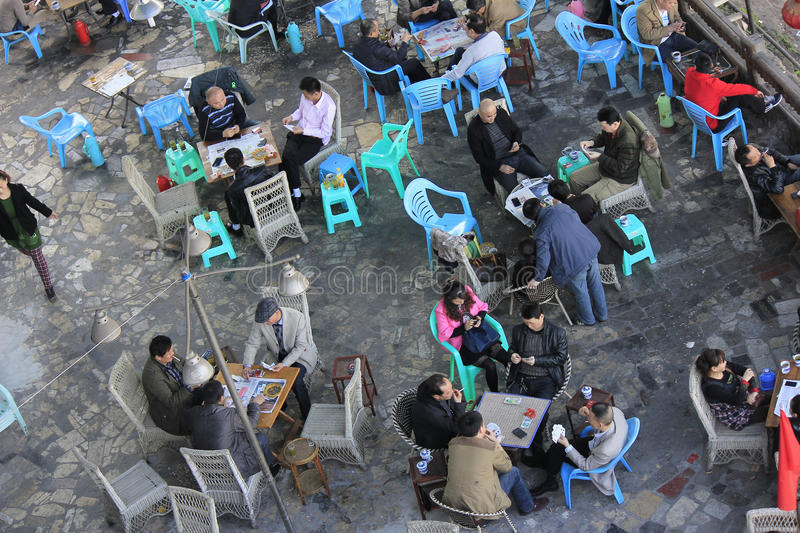 Chinese tea house. Overlooking the outdoor tea house, people playing poker. Photo taken on March 16, 2014 in Chongqing, China stock images