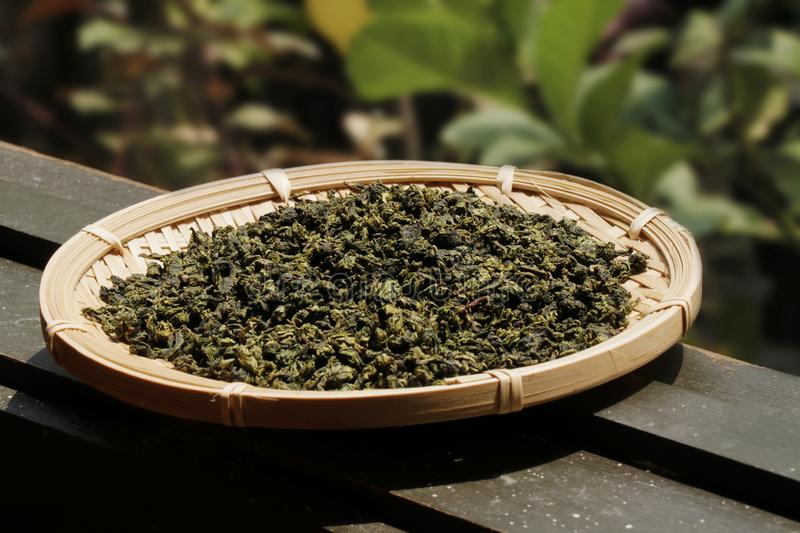 Chinese tea leaves on a basket plate royalty free stock image