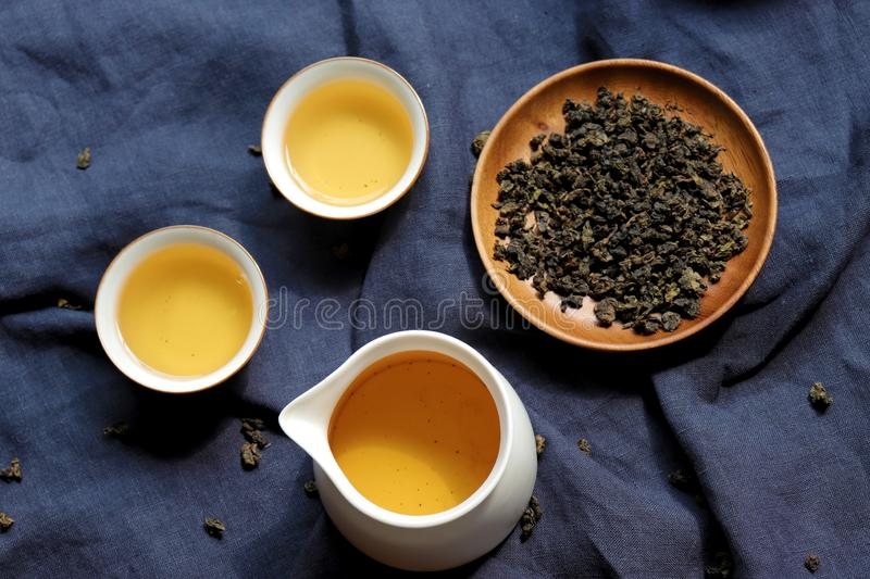 Chinese tea leaves and tea drinks on rustic wooden table royalty free stock images