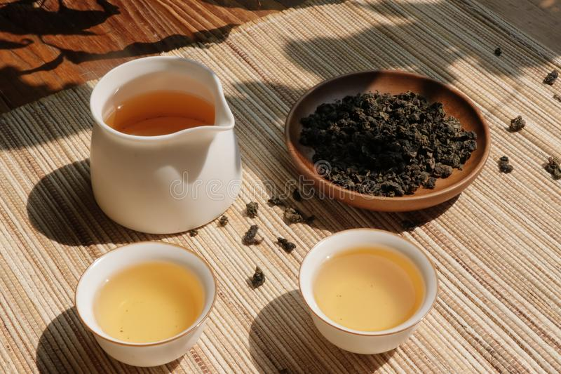 Chinese tea leaves and tea drinks on rustic wooden table royalty free stock photography