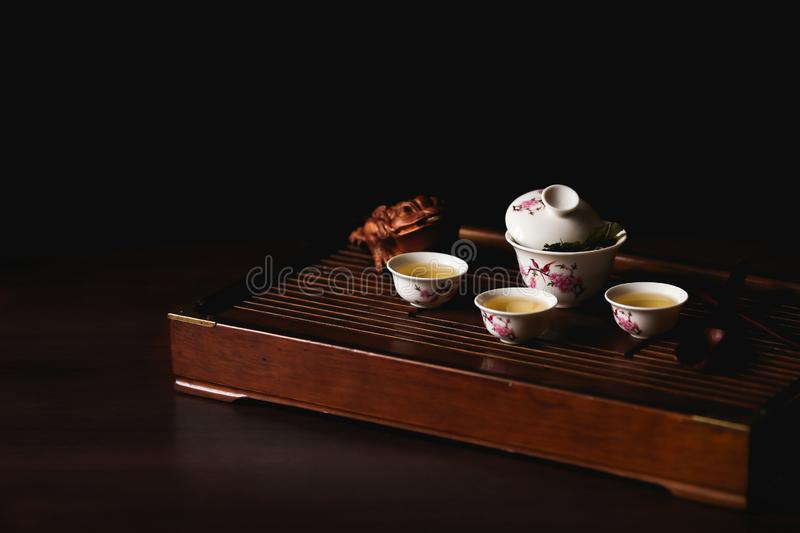 Chinese tea set on tea desk chaban on black background. Chinese tea ceremony. Soft selective focus stock images