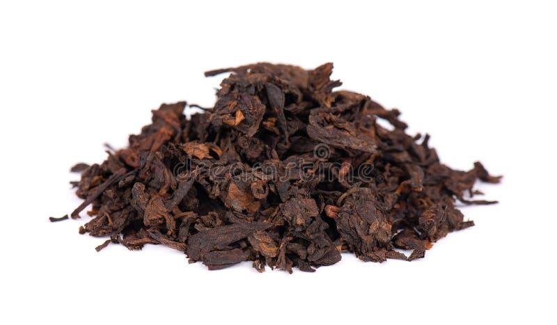 Chinese tea Shou Puer. Pressed fermented Pu-erh tea. Macro close up. Aromatic black puer tea. Healthy drink. royalty free stock photos