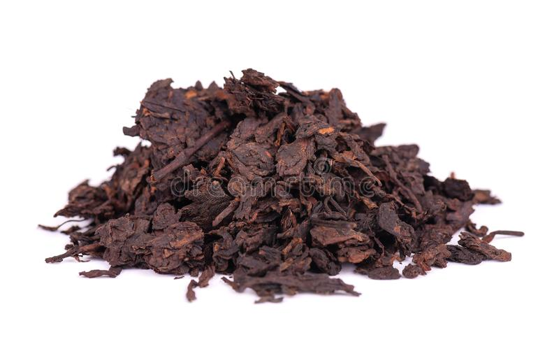 Chinese tea Shou Puer. Pressed fermented Pu-erh tea. Macro close up. Aromatic black puer tea. Healthy drink. royalty free stock images