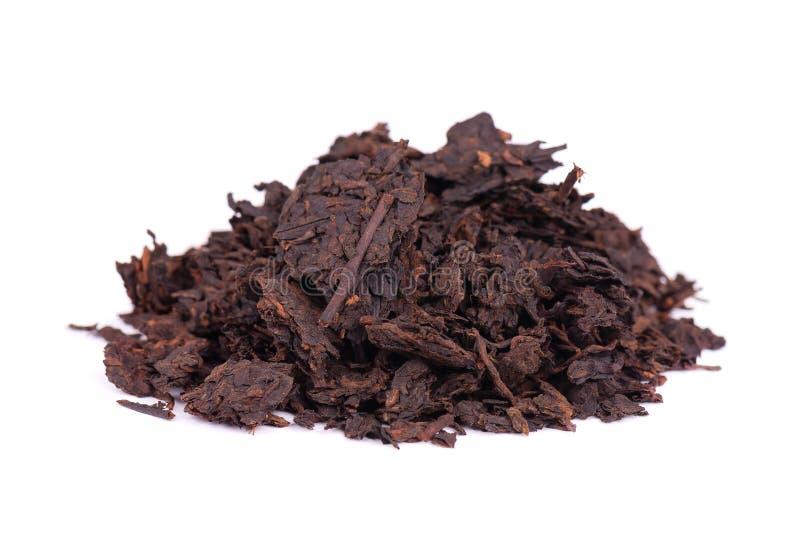 Chinese tea Shou Puer. Pressed fermented Pu-erh tea. Macro close up. Aromatic black puer tea. Healthy drink. royalty free stock photo