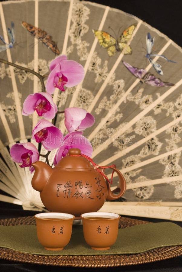 Chinese teapot and antique fan royalty free stock images