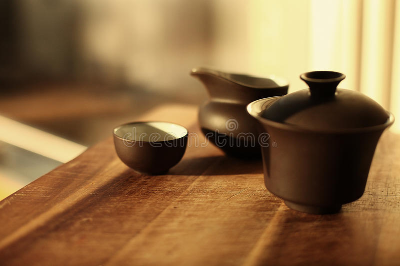 Chinese teapot on table in the sunlight royalty free stock photography