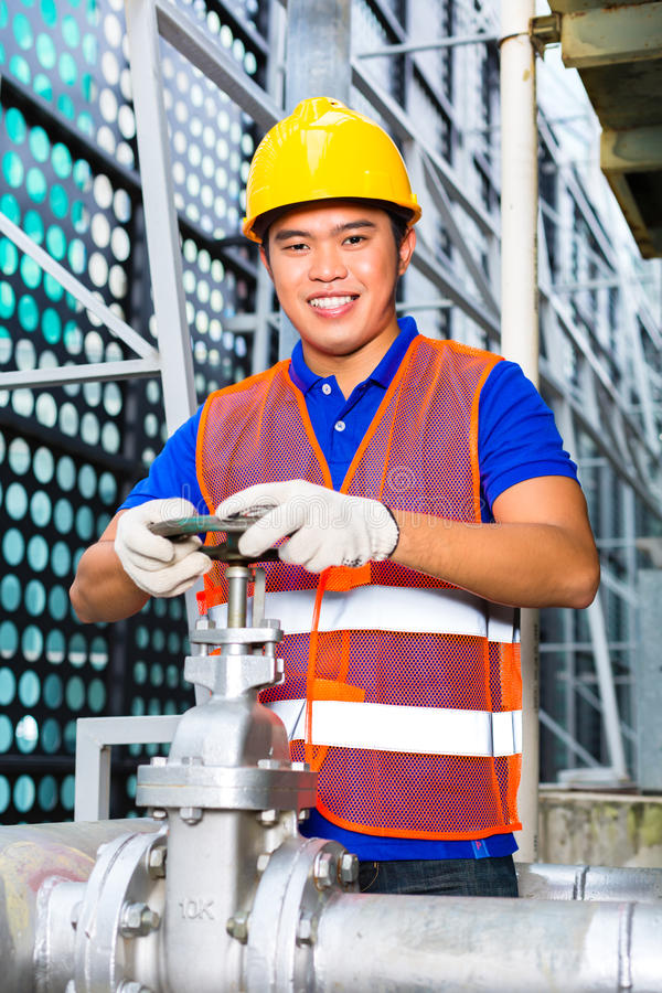 Download Chinese Technician Working On Valve Stock Photo - Image: 33399746