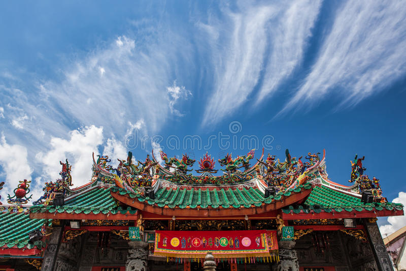 Chinese temple roof. And blue sky with clouds stock photo