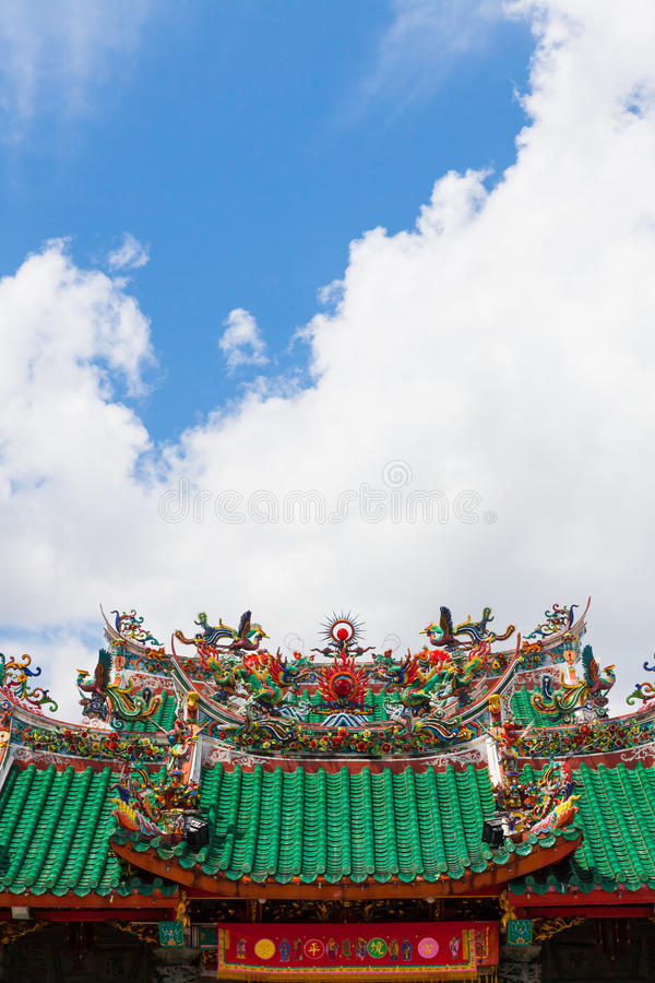 Chinese temple roof. And blue sky with clouds royalty free stock photo