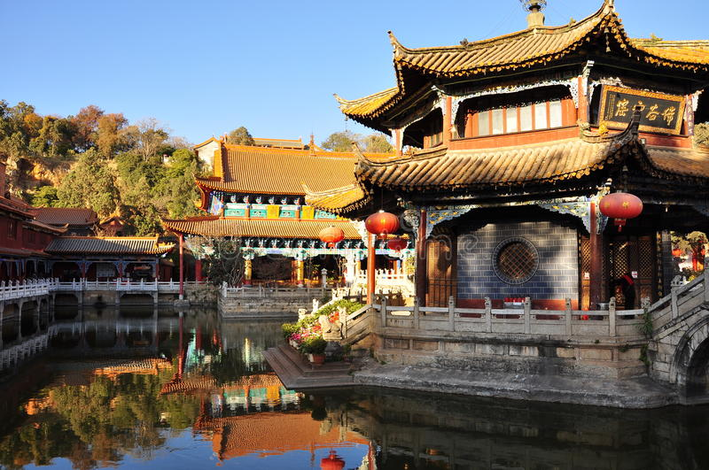 Chinese temple of Yuantong. Kunming, China. Chinese temple in the city of Kunming, China. Yuantong temple bridge and inner court pavillion and pond stock photo