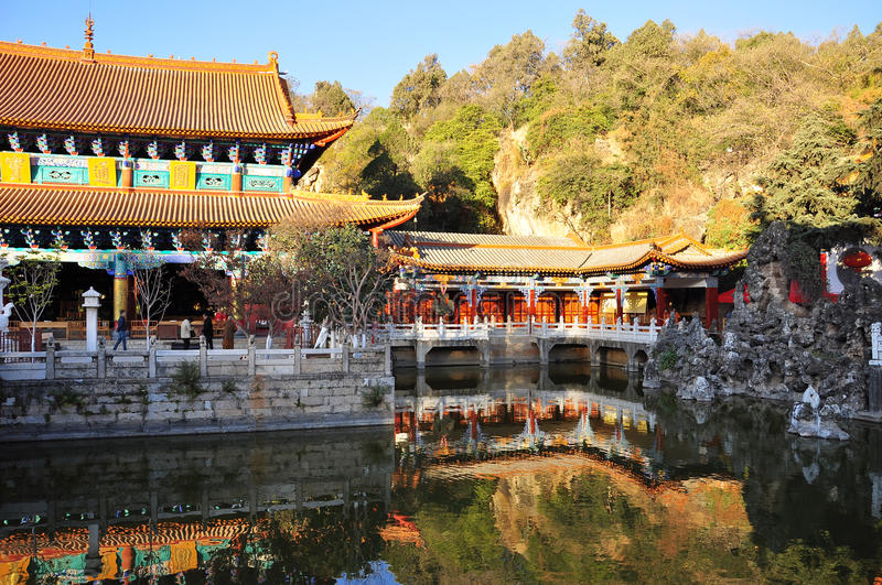 Chinese temple of Yuantong. Kunming, China. Chinese temple in the city of Kunming, China. Yuantong temple bridge and inner court pavillion and pond stock photography