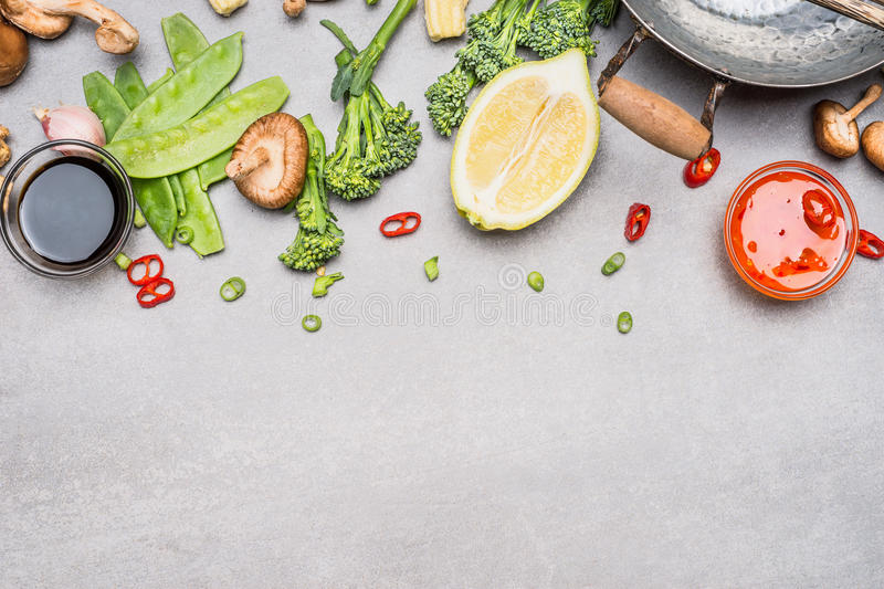 Chinese or Thai cuisine vegetables and spices cooking ingredients on gray stone background, top view. Border stock image