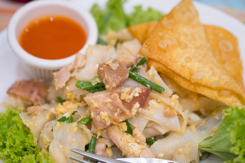 Chinese-Thai dish made with stir-fried rice noodles mixed with chicken royalty free stock photo
