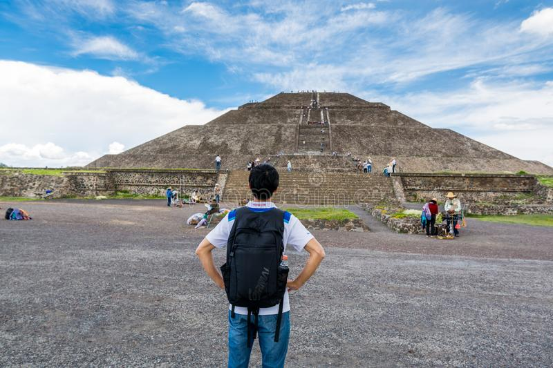 A Chinese tourist looking at the largest ruins of the architecturally significant Mesoamerican pyramids  in Teotihuacan, an. Ancient Mesoamerican city located stock photo