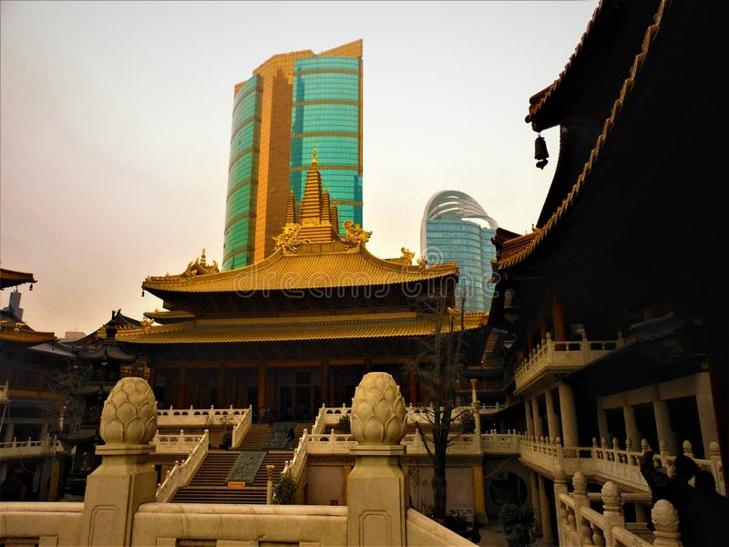 Chinese tradition and modernity, temple and skyscrapers. Religion and shopping, contrast and differences, contemporary China, luxury and worship stock images