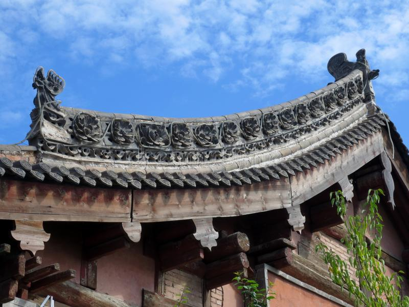Chinese traditional building roof. A ridge carved and assembled from tiles. Is the epitome of Chinese traditional culture royalty free stock photography