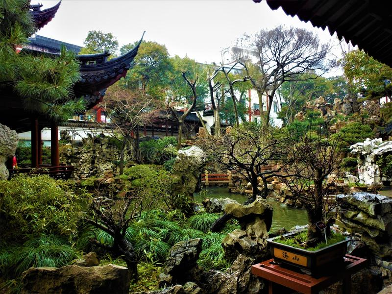 Chinese traditional garden, history, nature and art. Chinese traditional garden, tradition, history, time, art, architecture, nature and trees, sky and roof stock photography