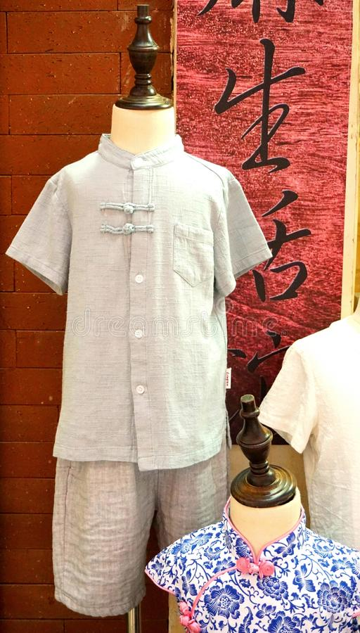 Chinese traditional linen clothes and qipao of childern stock photography