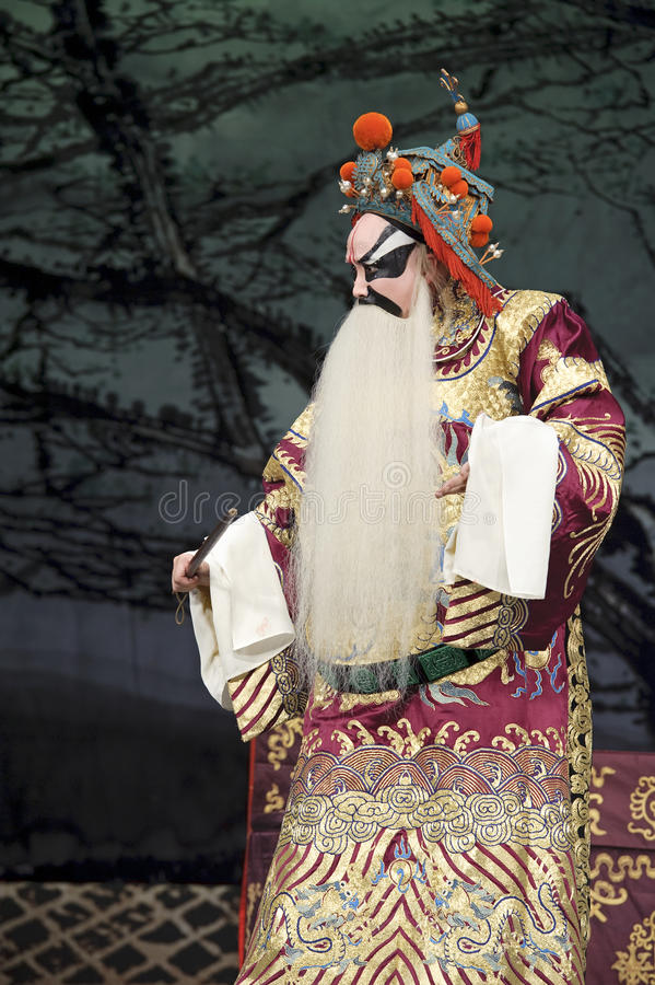 Chinese traditional opera actor with theatrical costume. Chinese traditional opera actor performs on stage royalty free stock photos