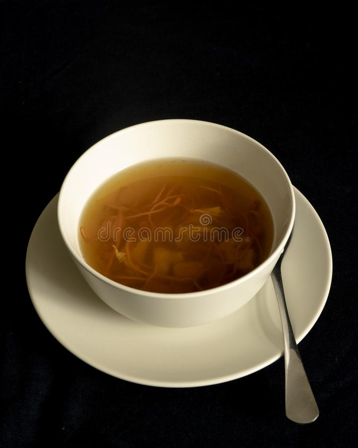 Chinese traditional nourishing health soup. A bowl of chinese traditional nourishing health soup, meat, cordyceps flower stock photography