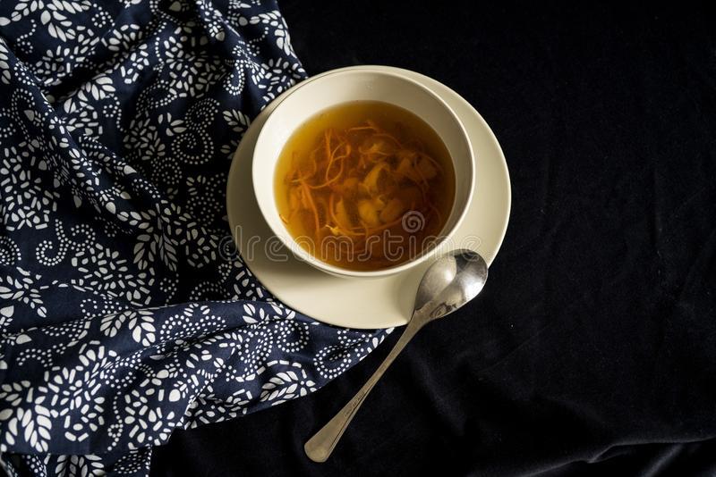 Chinese traditional nourishing health soup. A bowl of chinese traditional nourishing health soup, meat, cordyceps flower stock photo