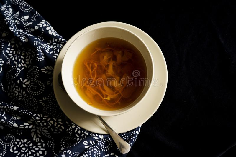 Chinese traditional nourishing health soup. A bowl of chinese traditional nourishing health soup, meat, cordyceps flower stock image