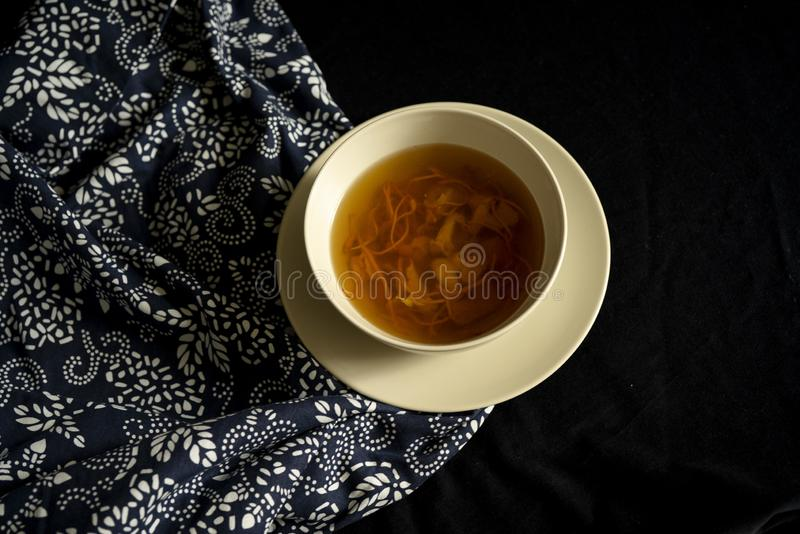 Chinese traditional nourishing health soup. A bowl of chinese traditional nourishing health soup, meat, cordyceps flower royalty free stock photography