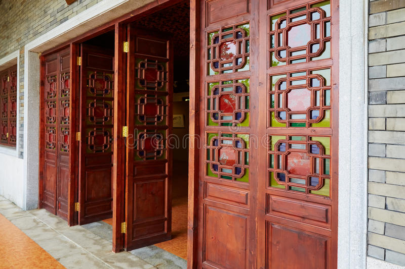 Asian Chinese wooden door wood gate of classic house. Asian Chinese wood door with classical decorative design and pattern in oriental ancient style. Wooden gate royalty free stock photos