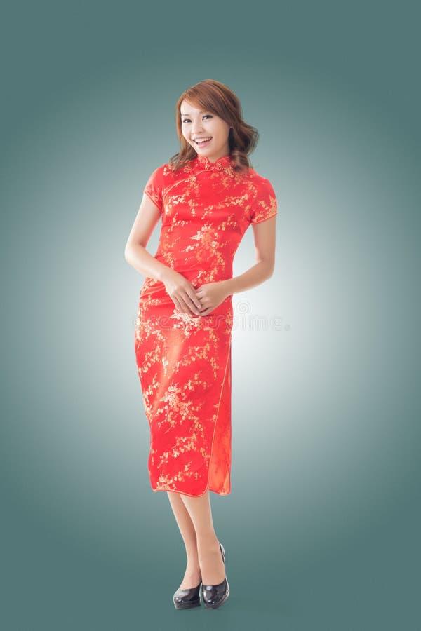 Chinese traditionele cheongsam van de vrouwenkleding royalty-vrije stock afbeeldingen
