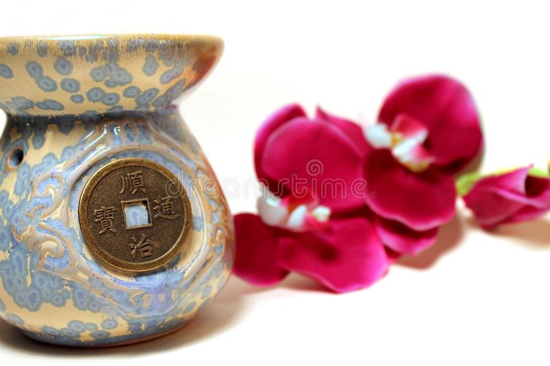Chinese vase with orchids on background stock photography