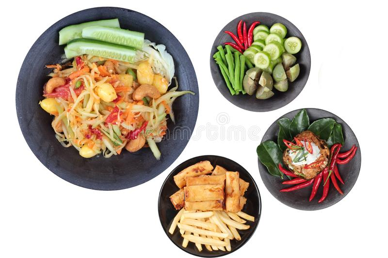 Chinese vegetable festival as spicy papaya salad with mixed vegetable, deep fried spring roll and French fries. Isolated of Chinese vegetable festival as spicy stock image