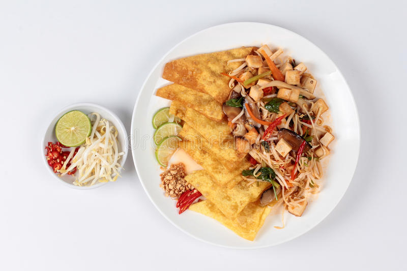 Chinese Vegetable festival food as crispy wonton with Thai fried mixed vegetable call 'Pad Thai J'. royalty free stock photo