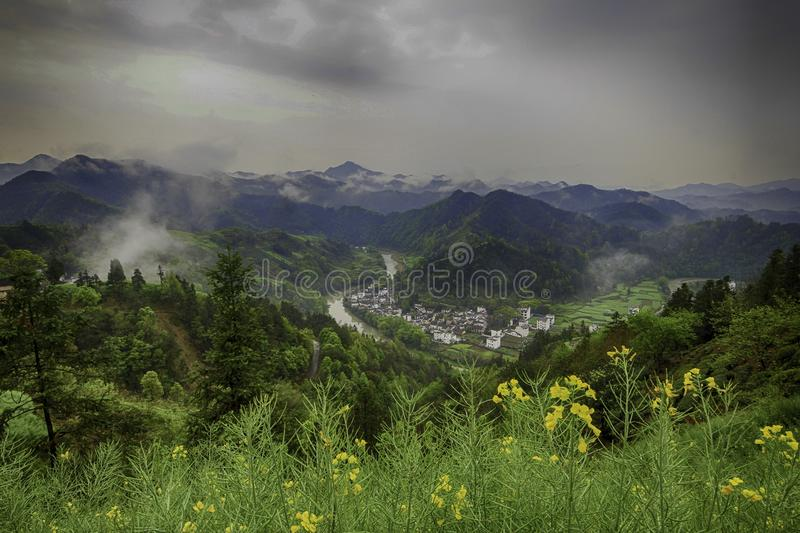 Village in a river valley royalty free stock image