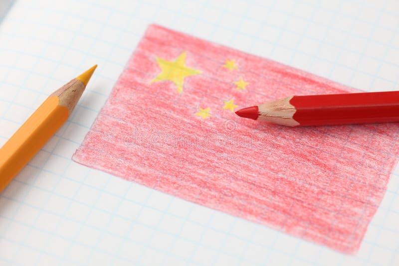 Chinese vlag in potlood binnen notitieboekje royalty-vrije stock foto's