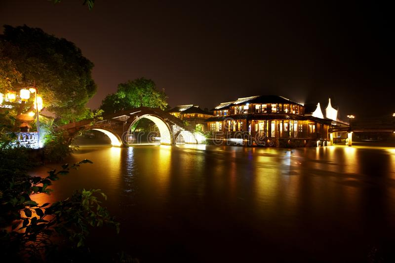 The Chinese watery town buildings. And marina by the river of night scenic,wuzhen,jiangsu,China stock image