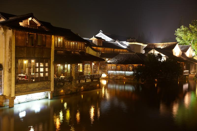 The Chinese watery town buildings. And marina by the river of night scenic,wuzhen,jiangsu,China stock photos