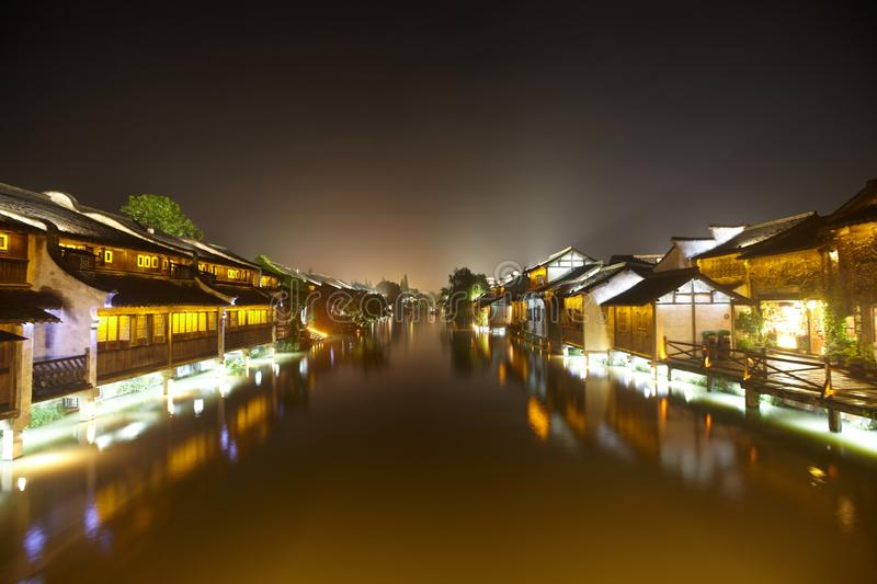 The Chinese watery town buildings. And marina by the river of night scenic,wuzhen,jiangsu,China royalty free stock photos