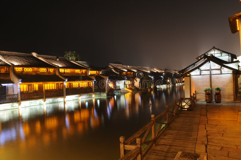 The Chinese watery town buildings. And marina by the river of night scenic,wuzhen,jiangsu,China royalty free stock photo