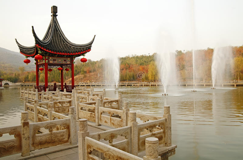 Chinese wayside pavilion in fall. Chinese ancient wayside pavilion on the lake in the autumn scenery stock photo