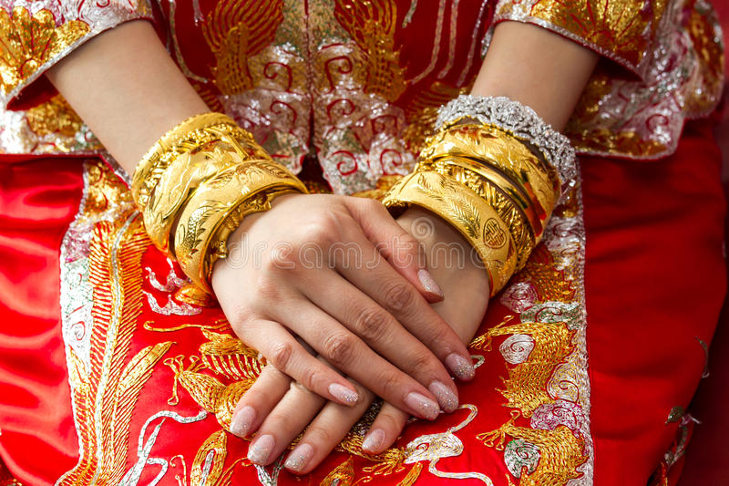 Chinese wedding ceremony with gold bangles stock image