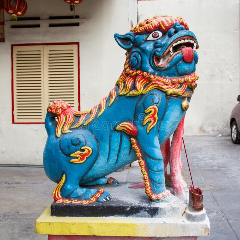 Chinese welcoming lion sculpture. Colored Chinese welcoming lion sculpture in front of a temple in Indonesia royalty free stock images