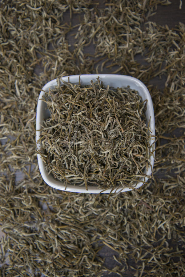 Chinese white tea is on the table. Chinese white tea `Bai Hao Yin Zhen` is on the table royalty free stock images