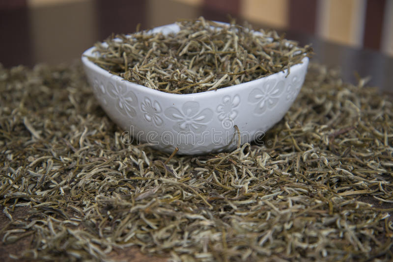 Chinese white tea is on the table. Chinese white tea `Bai Hao Yin Zhen` is on the table stock image