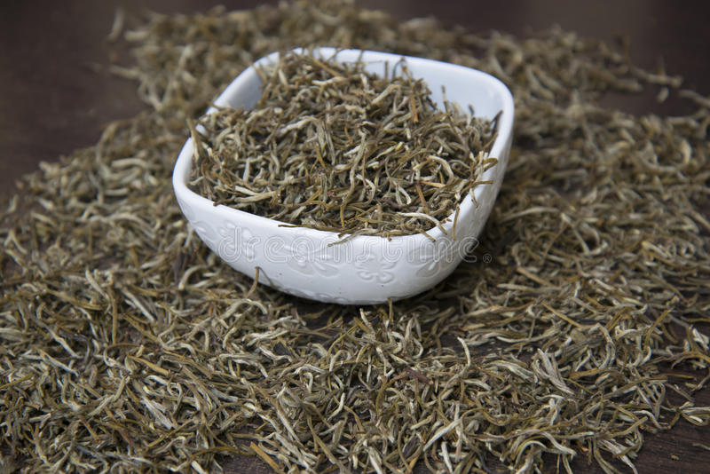 Chinese white tea is on the table. Chinese white tea `Bai Hao Yin Zhen` is on the table stock photos