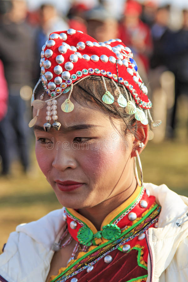 Chinese woman in ancient Chinese clothing during the Heqing Qifeng Pear Flower festival. Heqing, China - March 15, 2016: Chinese woman in ancient Chinese stock image