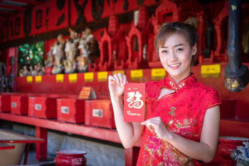 Chinese woman. Asian young girl wearing China Traditional dressing for Chinese new year culture. royalty free stock photos