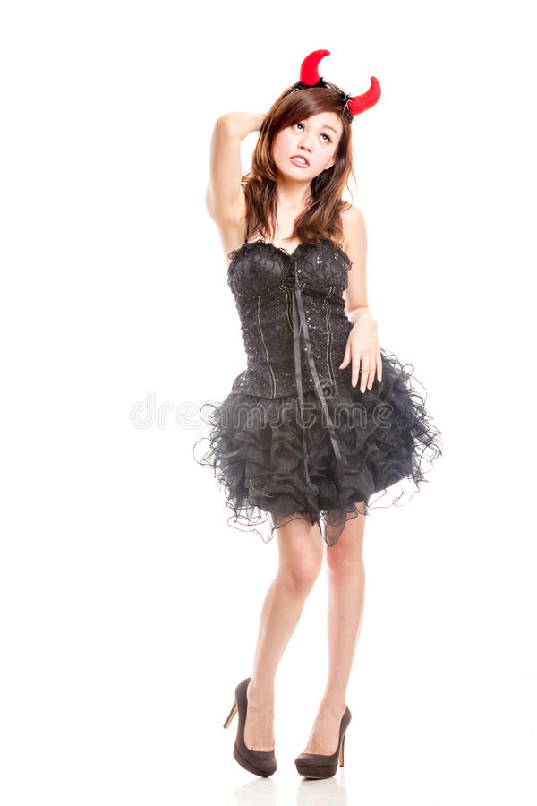 Chinese woman in black dress and devil horns stock photo
