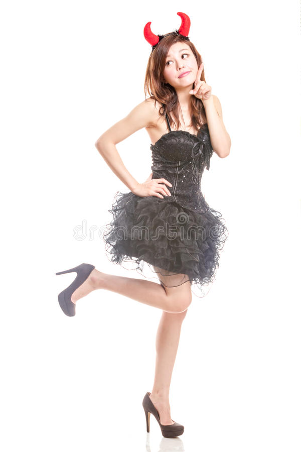 Chinese woman in black dress and devil horns royalty free stock image