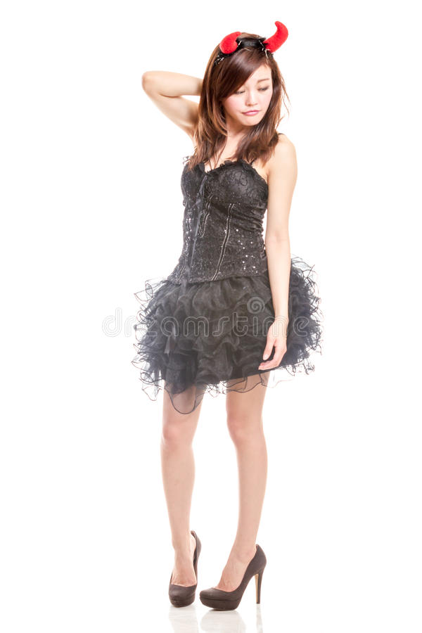 Chinese woman in black dress and devil horns royalty free stock photos